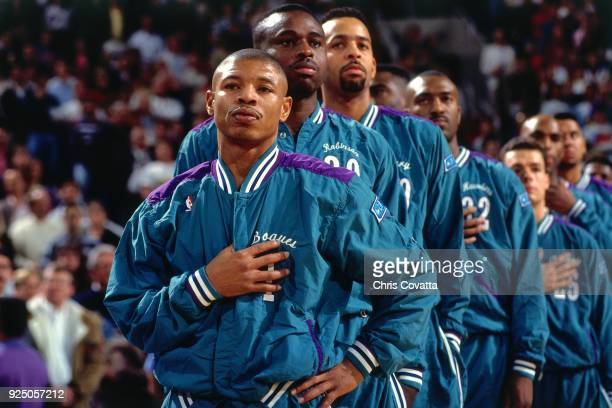 Muggsy Bogues of the Charlotte Hornets stands for the National Anthem during a game on January 11 1994 at America West Arena in Phoenix Arizona NOTE...