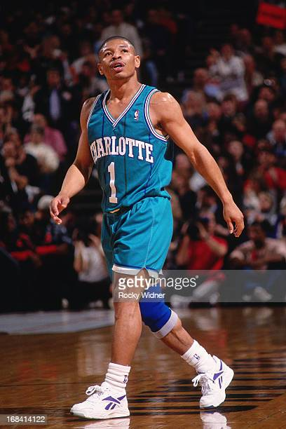 Muggsy Bogues of the Charlotte Hornets walks against the Portland Trail Blazers during a game played on January 16 1994 at the Veterans Memorial...