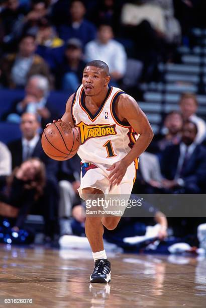 Muggsy Bogues of the Golden State Warriors drives against the Cleveland Cavaliers on December 3 1997 at Oracle Arena in Oakland California NOTE TO...