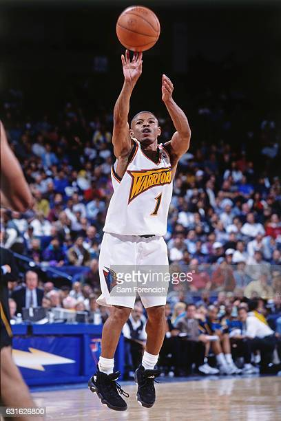 Muggsy Bogues of the Golden State Warriors shoots against the Detroit Pistons on November 12 1997 at Oracle Arena in Oakland California NOTE TO USER...
