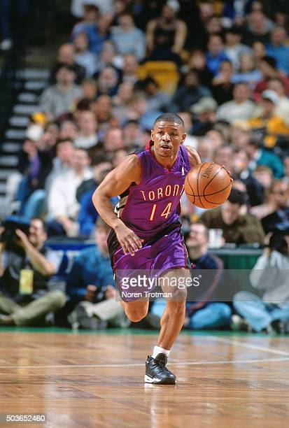 Muggsy Bogues of the Toronto Raptors drives against the Boston Celtics on March 1 2000 at the FleetCenter in Boston Massachusetts NOTE TO USER User...