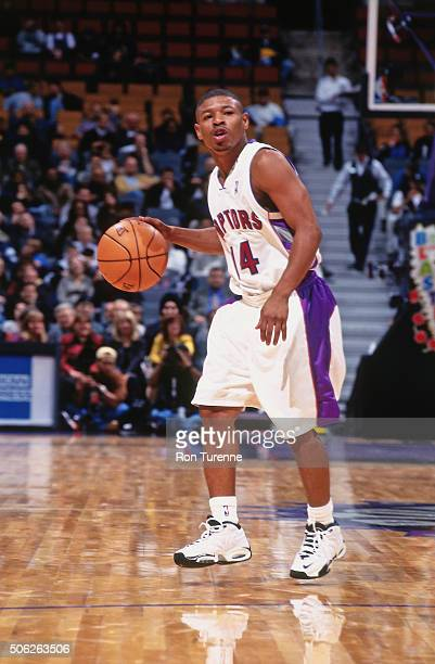 Muggsy Bogues of the Toronto Raptors drives against the Milwaukee Bucks on October 10 1999 at the Air Canada Centre in Toronto Ontario in Canada NOTE...