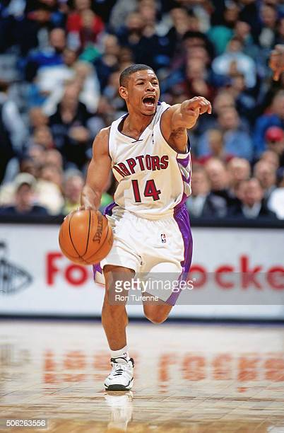 Muggsy Bogues of the Toronto Raptors passes against the New Jersey Nets on December 21 1999 at the Air Canada Centre in Toronto Ontario in Canada...