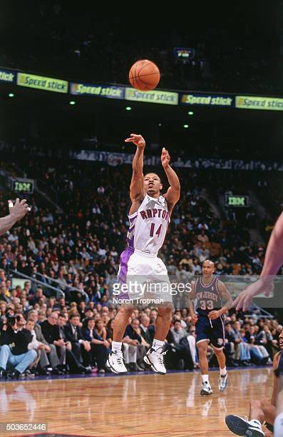 Muggsy Bogues of the Toronto Raptors shoots against the New Jersey Nets on December 21 1999 at the Air Canada Centre in Toronto Ontario Canada NOTE...