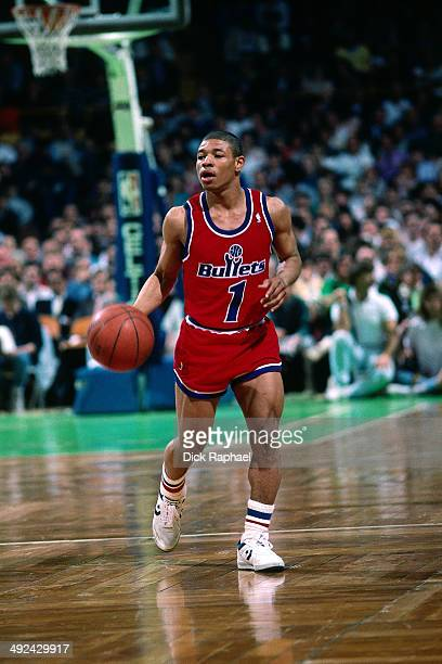 Muggsy Bogues of the Washington Bullets drives against the Boston Celtics during a game circa 1988 at the Boston Garden in Boston Massachusetts NOTE...
