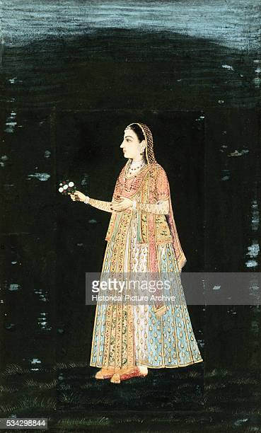 Mughal Miniature Painting Depicting a Lady Holding Flowers