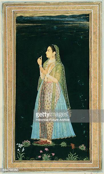 Mughal Miniature Painting Depicting a Woman Holding a Blossom at Night