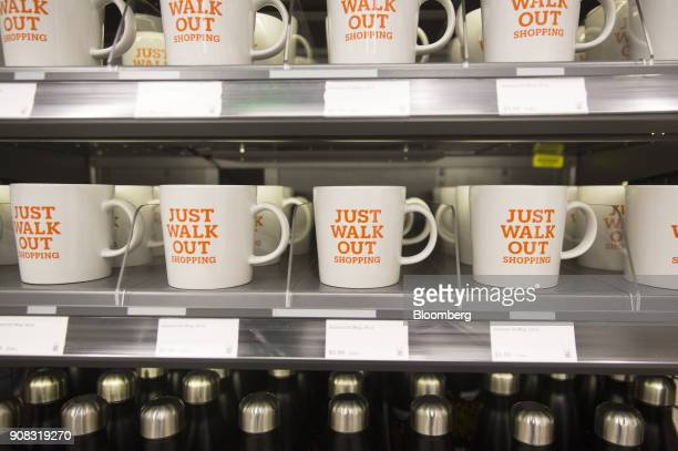 Mugs are displayed for sale at the Amazon Go store in Seattle Washington US on Wednesday Jan 17 2018 After more than a year of testing with an...