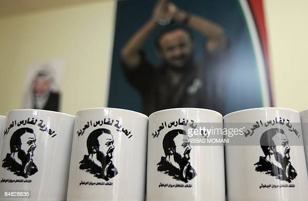 Mugs bearing a portrait of jailed Fatah leader Marwan Barghuti and reading in Arabic 'Freedom for the knight of freedom' are displayed at an office...