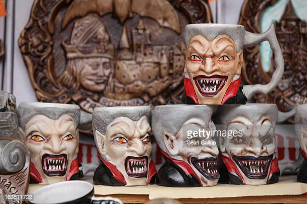 Mugs bearing a rendition of Dracula are displayed at a souvenir shop at Bran Castle famous as 'Dracula's Castle' on March 10 2013 in Bran Romania...