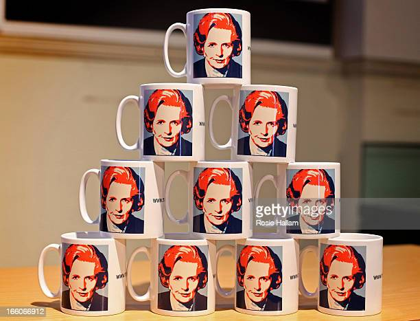 Mugs bearing the image of former Prime Minister Margaret Thatcher are displayed with other memorabilia at the Grantham Museum in her hometown on...