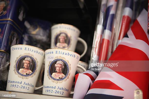 Mugs celebrating the Diamond Jubilee of Her Majesty Queen Elizabeth II on sale in Trafalgar Square on June 1 2012 in London England With two days to...