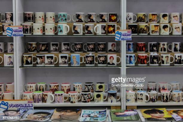 Mugs featuring images of Japanese pop stars are on display in the Korean Town neighborhood of Shinokubo Station Tokyo Japan October 16 2017