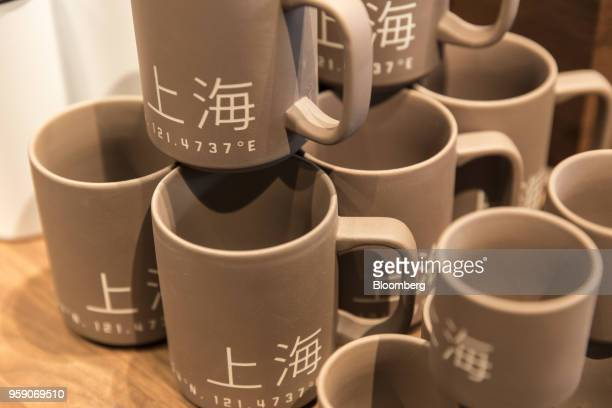 Mugs featuring the Chinese characters for 'Shanghai' stand on display inside the Starbucks Corp Reserve Roastery store in Shanghai China on Friday...
