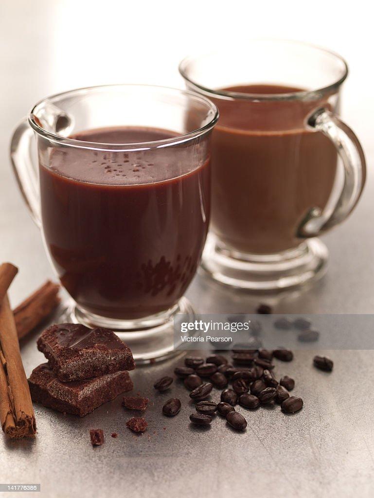 Mugs of Mexican Coffee with chocolate & cinnamon. : Stock Photo