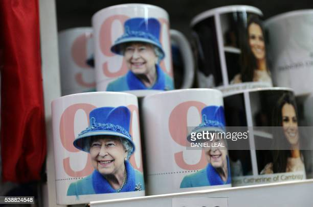 Mugs showing a smiling Queen are pictured in a souvenir shop in Oxford Circus in central London on June 8 as Britain prepares to celebrate the 90th...
