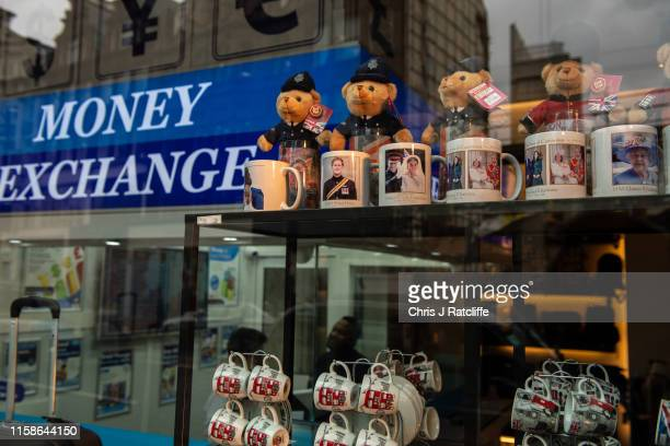 Mugs with pictures of the Royal family in the window of a shop and bureau de change in Kensington as British Pound Sterling has slumped to a 28month...