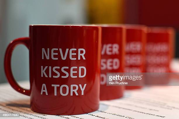 Mugs with the slogan 'Never Kissed a Tory' on display at the LGBT stand during the second day of the Labour Party Autumn Conference on September 28...