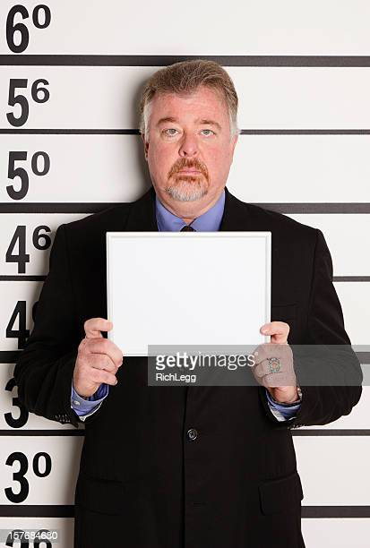 mugshot d'un homme d'affaires - mugshot photos et images de collection