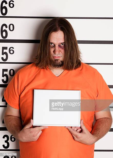 Mugshot of a Large Man in Prison Uniform