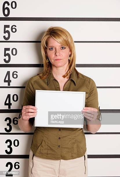 mugshot of a woman - police mugshot stock pictures, royalty-free photos & images