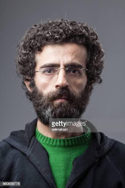 Mugshot Of Adult man With Facial Hair