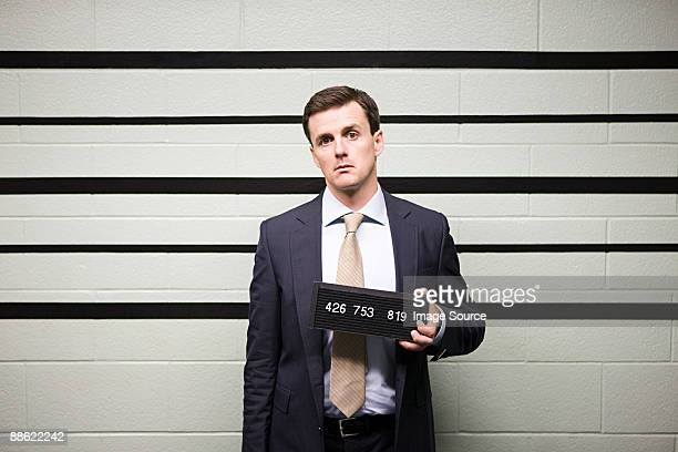 mugshot of businessman - criminal stock pictures, royalty-free photos & images