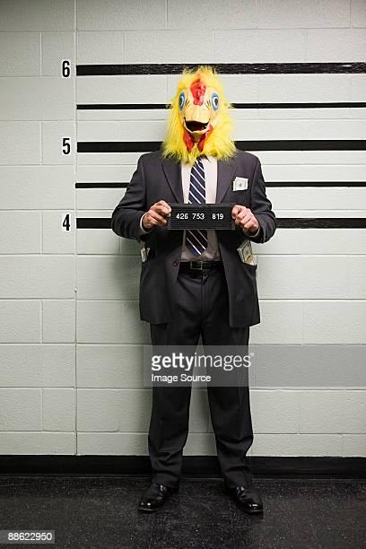 Mugshot of businessman with chicken head