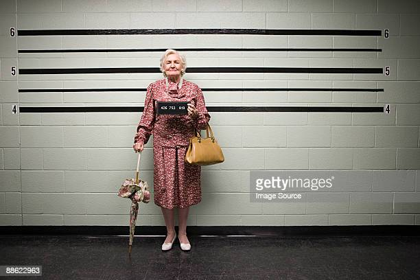 mugshot of senior woman - criminal stock pictures, royalty-free photos & images