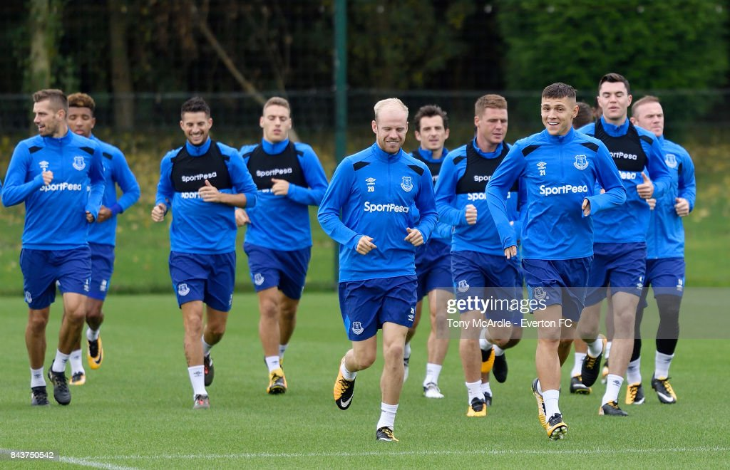Muhamed Besic And Davy Klaassen Warm Up With Teammates