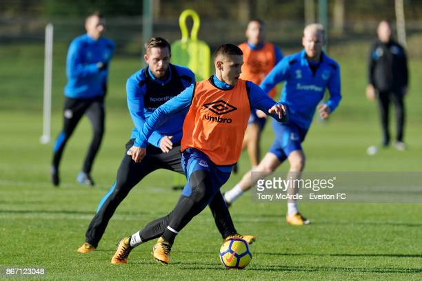 Muhamed Besic and Gylfi Sigurdsson and Dominic CalvertLewin challenge for the ball during the Everton training session at USM Finch Farm on October...