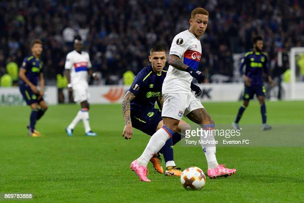 Muhamed Besic of Everton and Memphis Depay challenge for the ball during the UEFA Europa League match between Olympique Lyon and Everton at Groupama...