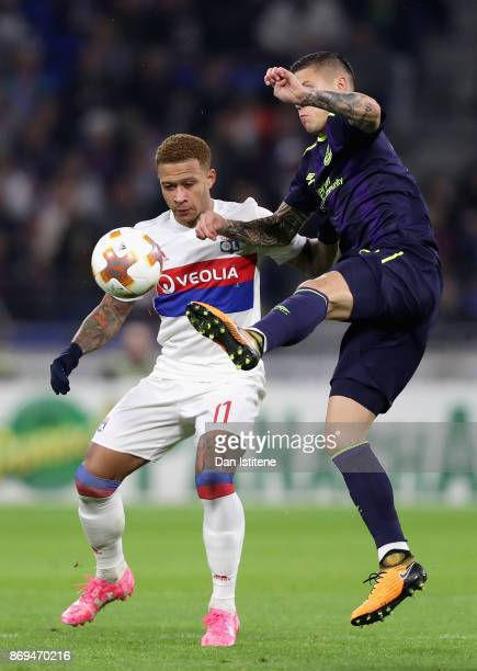 Muhamed Besic of Everton and Memphis Depay of Lyon battle for possession during the UEFA Europa League group E match between Olympique Lyon and...