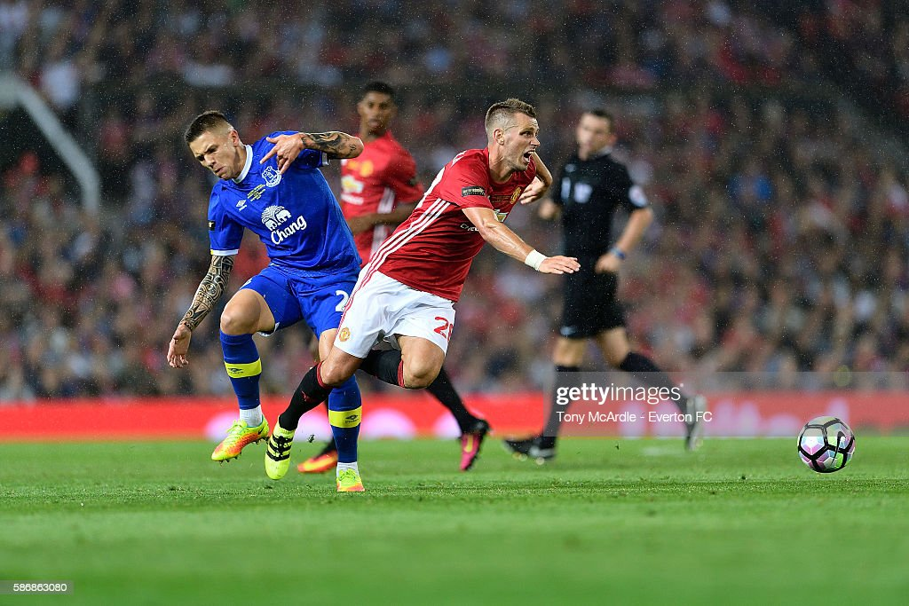 Muhamed Besic of Everton and Morgan Schneiderlin come together during the Wayne Rooney testimonial match between Manchester United and Everton at Old Trafford on August 3 2016 in Manchester, England.