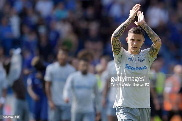Muhamed Besic of Everton applauds the Everton fans after the Premier League match between Chelsea and Everton at Stamford Bridge on August 27 2017 in...