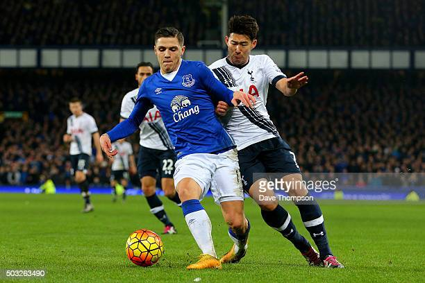 Muhamed Besic of Everton battles for the ball with HeungMin Son of Tottenham Hotspur during the Barclays Premier League match between Everton and...