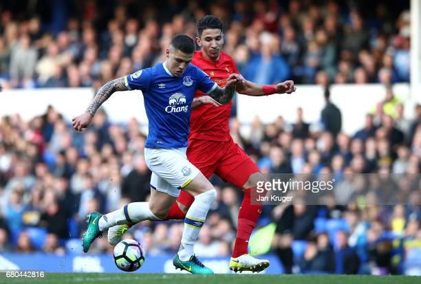 Muhamed Besic of Everton controls the ball from Marko Grujic of Liverpool during the Premier League 2 match between Everton and Liverpool at Goodison...