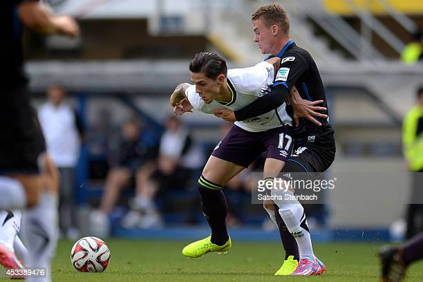 Muhamed Besic of Everton is challenged by Victor Maier of Paderborn during the pre season friendly match between SC Paderborn and Everton FC at...
