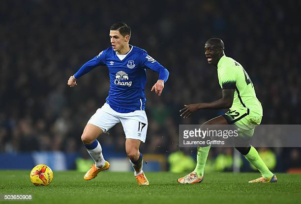 Muhamed Besic of Everton is closed down by Yaya Toure of Manchester City during the Capital One Cup Semi Final First Leg match between Everton and...