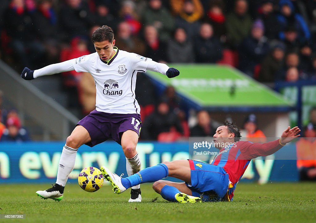 Muhamed Besic Of Everton Is Tackled By Marouane Chamakh Of