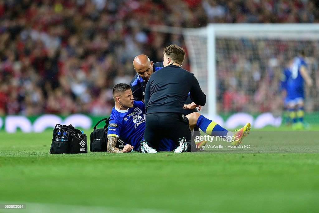 Muhamed Besic of Everton is treated on the pitch injury during the Wayne Rooney testimonial match between Manchester United and Everton at Old Trafford on August 3 2016 in Manchester, England.