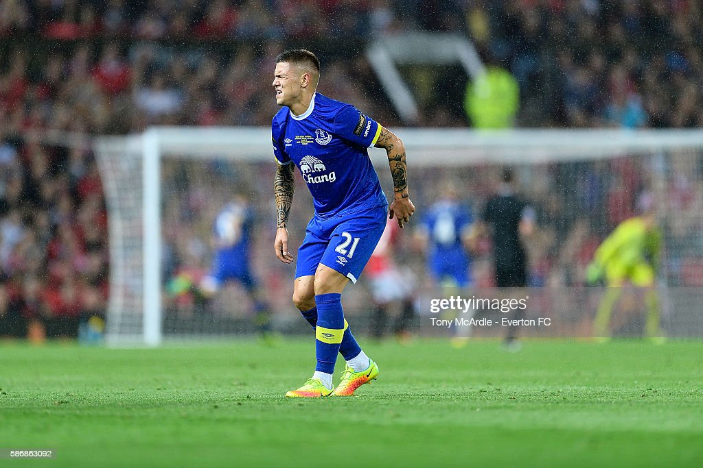 Muhamed Besic of Everton reacts to his knee injury during the Wayne Rooney testimonial match between Manchester United and Everton at Old Trafford on August 3 2016 in Manchester, England.
