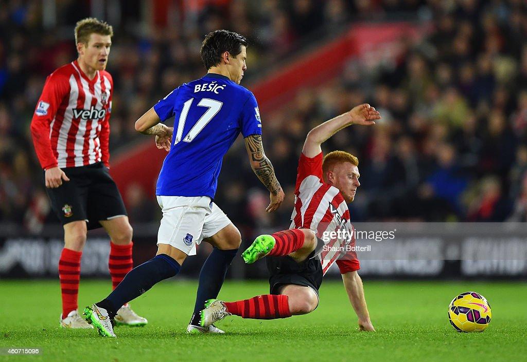 Muhamed Besic Of Everton Tackles Harrison Reed Of