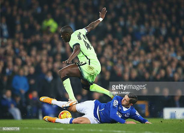 Muhamed Besic of Everton tackles Yaya Toure of Manchester City during the Capital One Cup Semi Final First Leg match between Everton and Manchester...