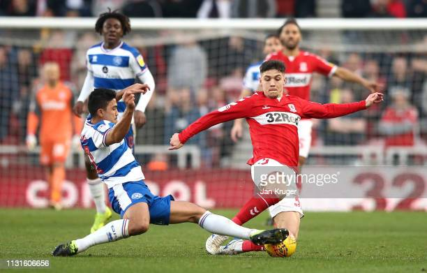 Muhamed Besic of Middlesbrough and Massimo Luongo of Queens Park Rangers challenge for the ball during the Sky Bet Championship match between...