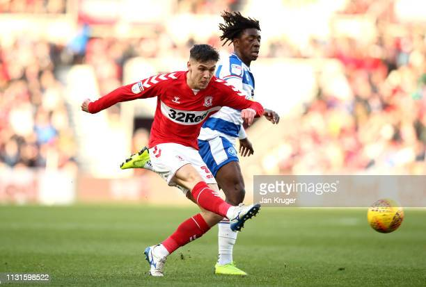 Muhamed Besic of Middlesbrough shoots at goal under pressure from Eberechi Eze of Queens Park Rangers during the Sky Bet Championship match between...