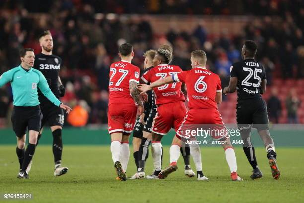Muhamed Besic of Middlesbrough with Ben Gibson of Middlesbrough after Basic clashes with Samuel Saiz of Leeds United at full time during the Sky Bet...