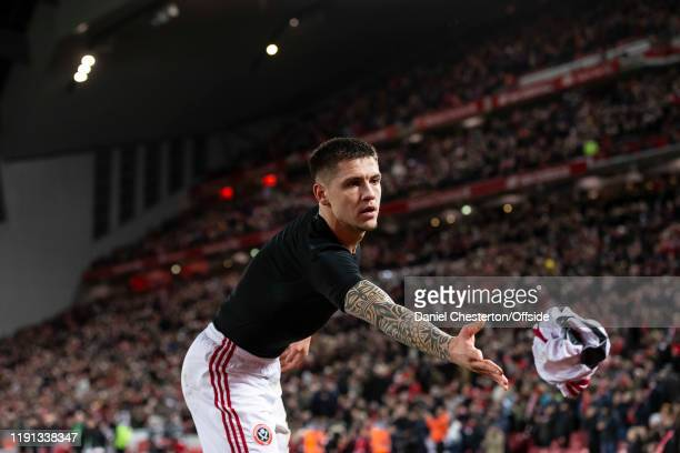 Muhamed Besic of Sheffield United throws his shirt to a fan after the Premier League match between Liverpool FC and Sheffield United at Anfield on...