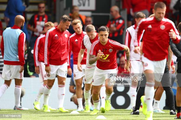 Muhamed Besic of Sheffield United warms up prior to the Premier League match between AFC Bournemouth and Sheffield United at Vitality Stadium on...