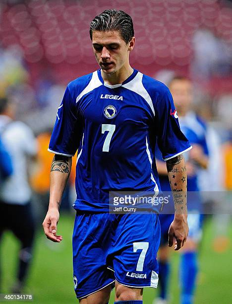 Muhamed Besic of the BosniaHerzegovina walks off the field after a friendly match against Ivory Coast at Edward Jones Dome on May 30 2014 in St Louis...